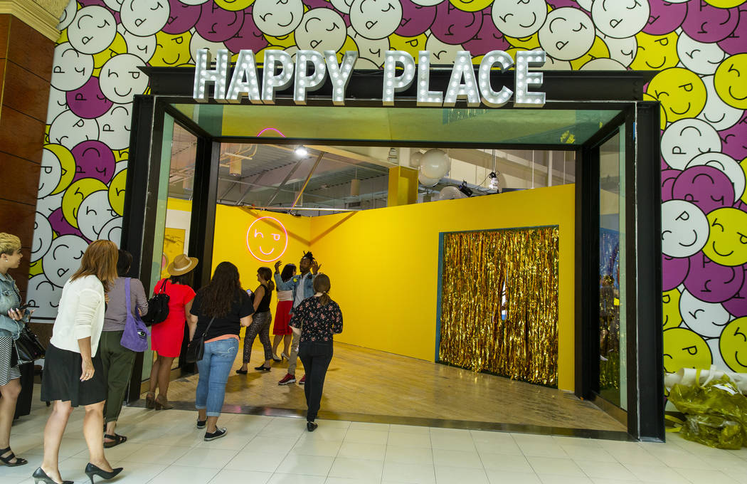 Invited guests enter the new Happy Place popup at Mandalay Bay on Wednesday, Aug. 21, 2019, in ...