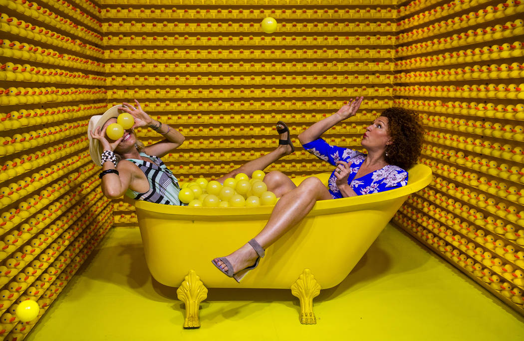 Vanessa Esparza, left, and Tevis Holboron play around in the Bathtub of Fun at the new Happy Pl ...