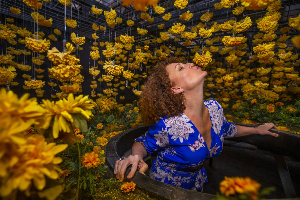 Tevis Holboron kisses a flower in the Superbloom Room at the new Happy Place popup at Mandalay ...