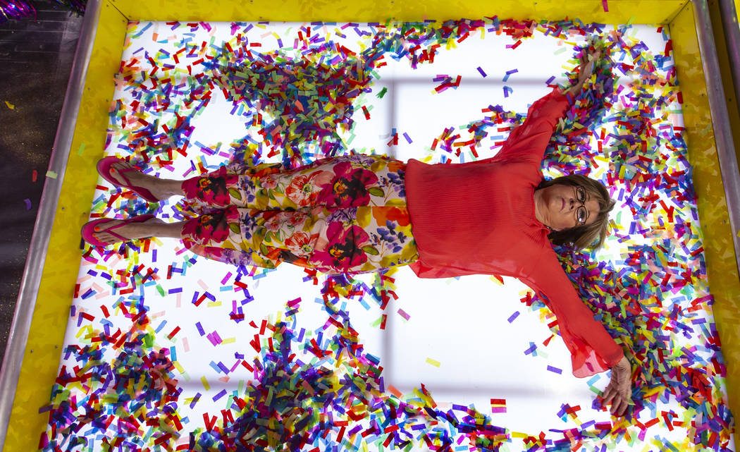 Debbie Kaye lays down and makes a confetti angel while in the Confetti Angels Room at the new H ...