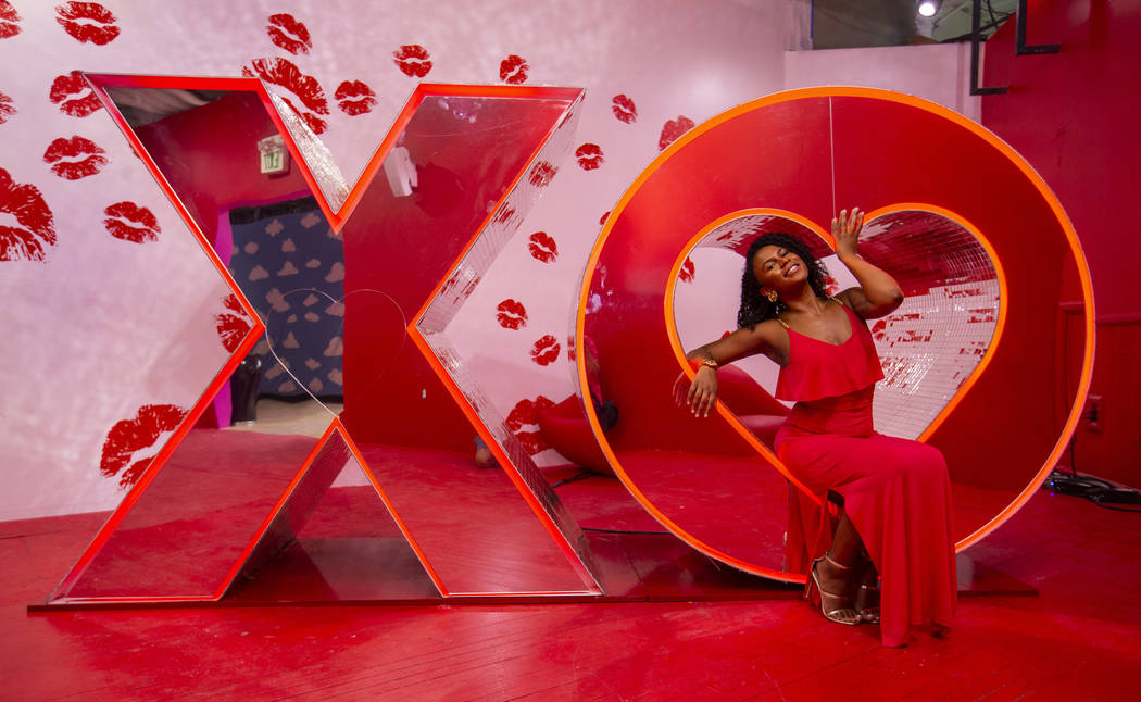 Avery Simone strikes a pose in the XO Room at the new Happy Place popup at Mandalay Bay on Wedn ...