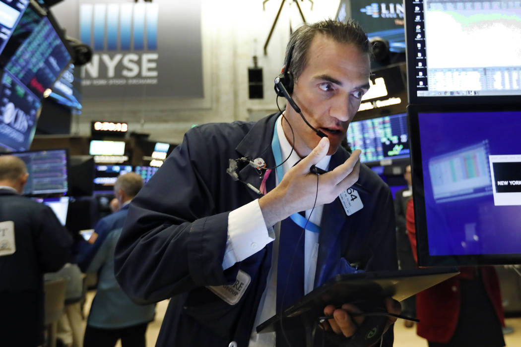 Trader Gregory Rowe works on the floor of the New York Stock Exchange, Wednesday, Aug. 21, 2019 ...
