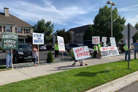 Protesters opposing a state Board of Ethics decision to dismiss two complaints against Storey C ...