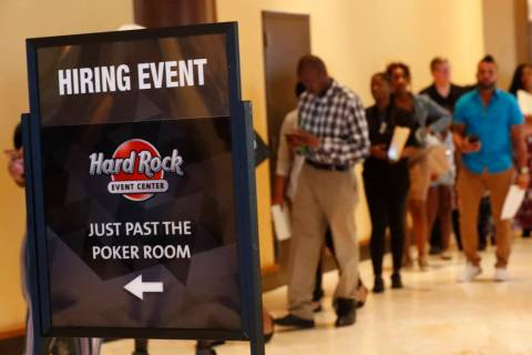 In this June 4, 2019 file photo, job applicants line up at the Seminole Hard Rock Hotel & Casin ...