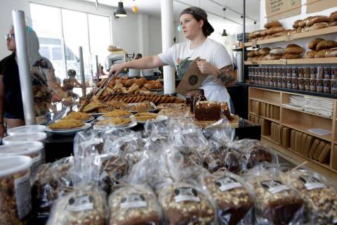 FILE - In this June 20, 2018 file photo, Audrey Wright waits on a customer at Zak the Baker in ...