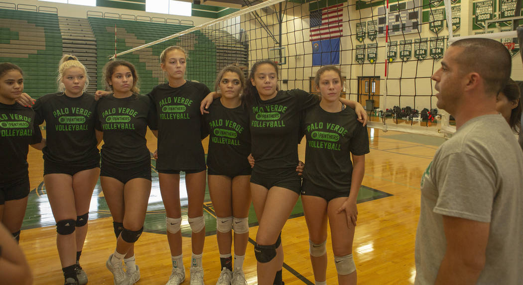 The varsity volleyball team listen to their coach during practice at Palo Verde High School on ...