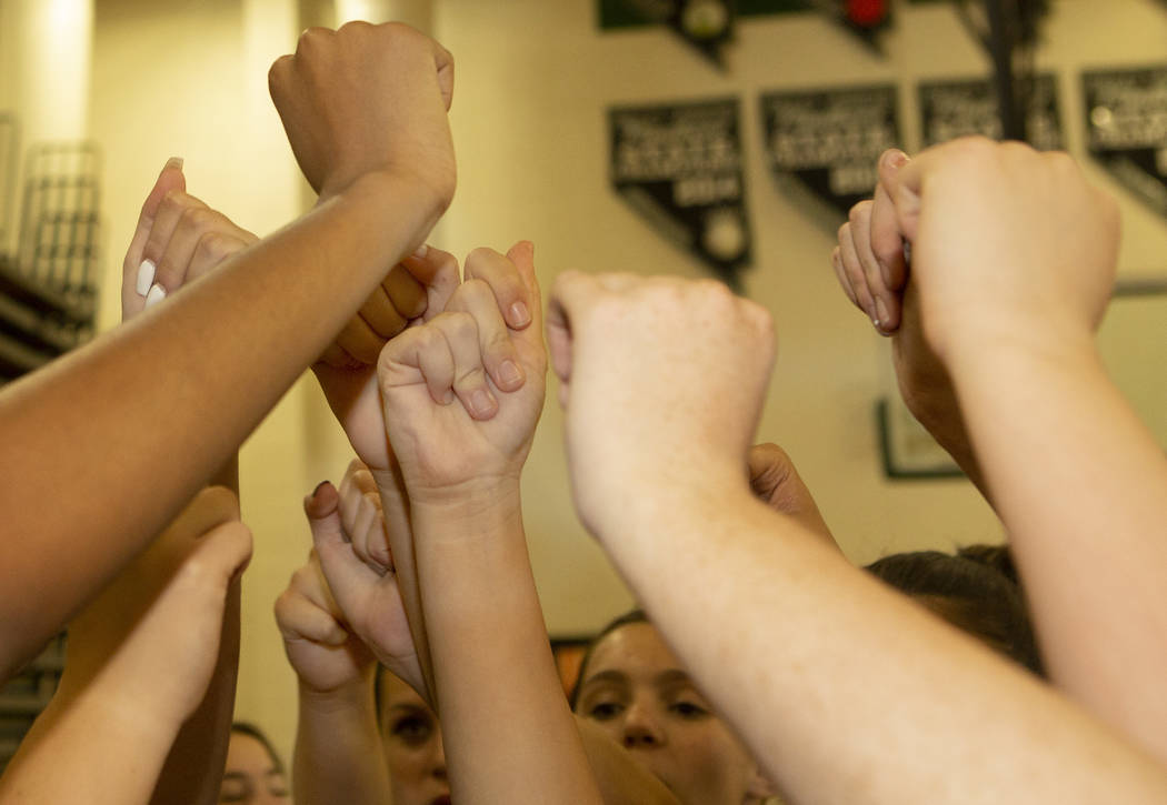 The junior varsity volleyball team go in for a huddle during a break at Palo Verde High School ...
