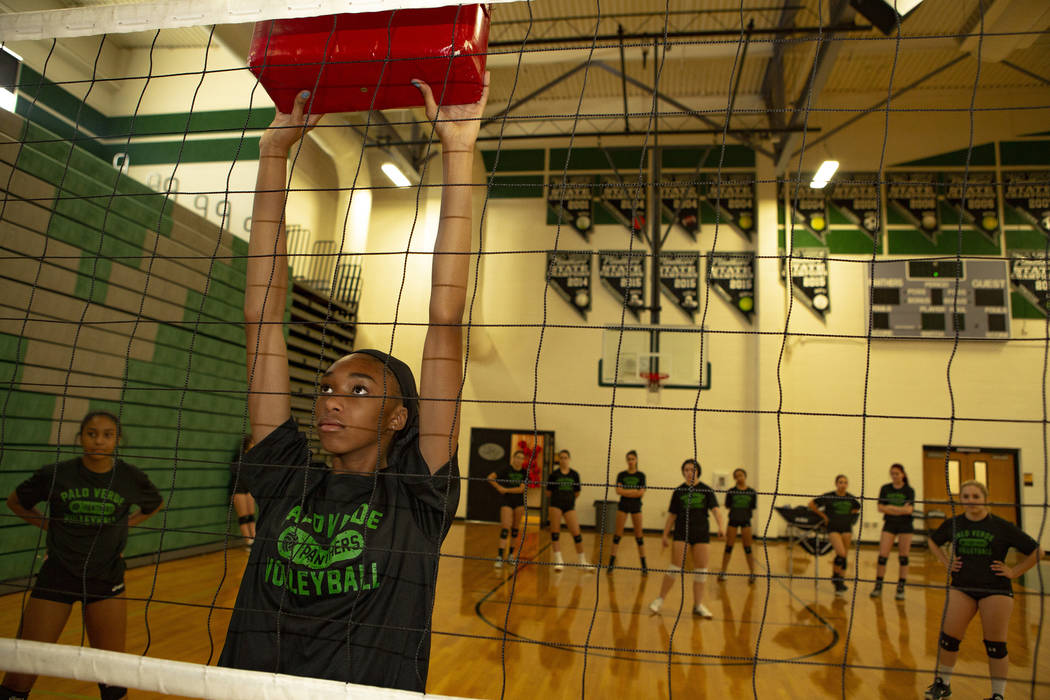 Naomi White, 14, freshman, holds a pad to work on defense during volleyball practice at Palo Ve ...