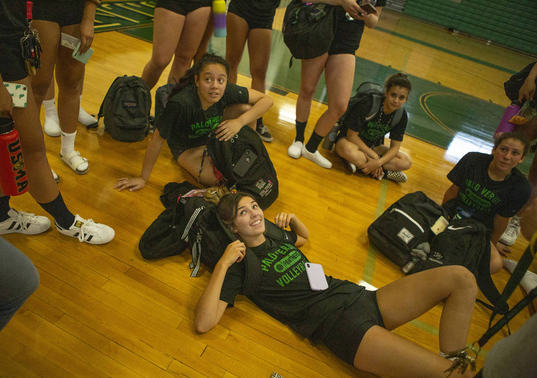Team captains Carli Tanner, 17, front, and Arien Fafard, 17, back, listen to their coaches with ...
