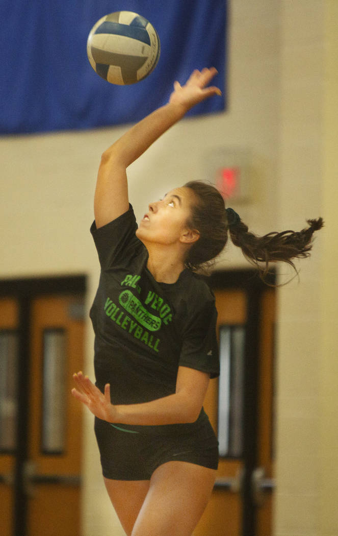 Alex Elliot, 17, senior, spikes the ball during volleyball practice at Palo Verde High School o ...