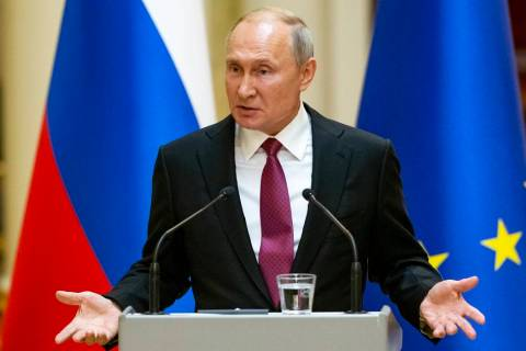 Russian President Vladimir Putin speaks during a news conference after his meeting with Preside ...