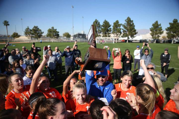 Bishop Gorman raise their trophy in celebration of their 4-0 win against Galena in the 4A girls ...
