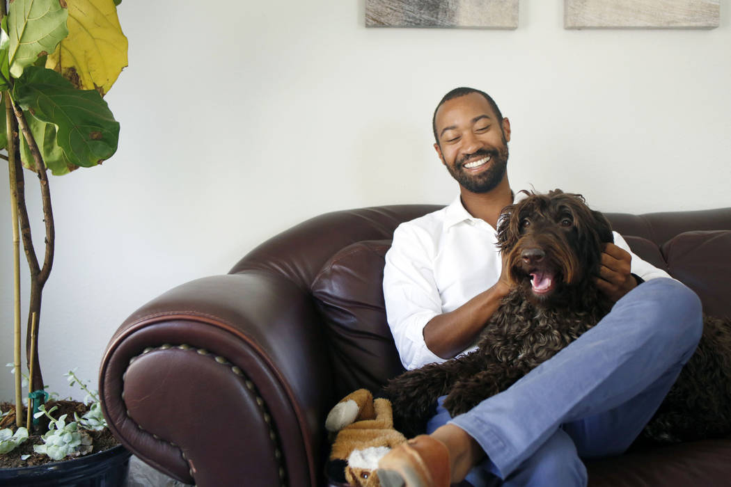 CEO of Silver State Health Ryan Linden with his dog Murphy, in his office at the Silver State H ...