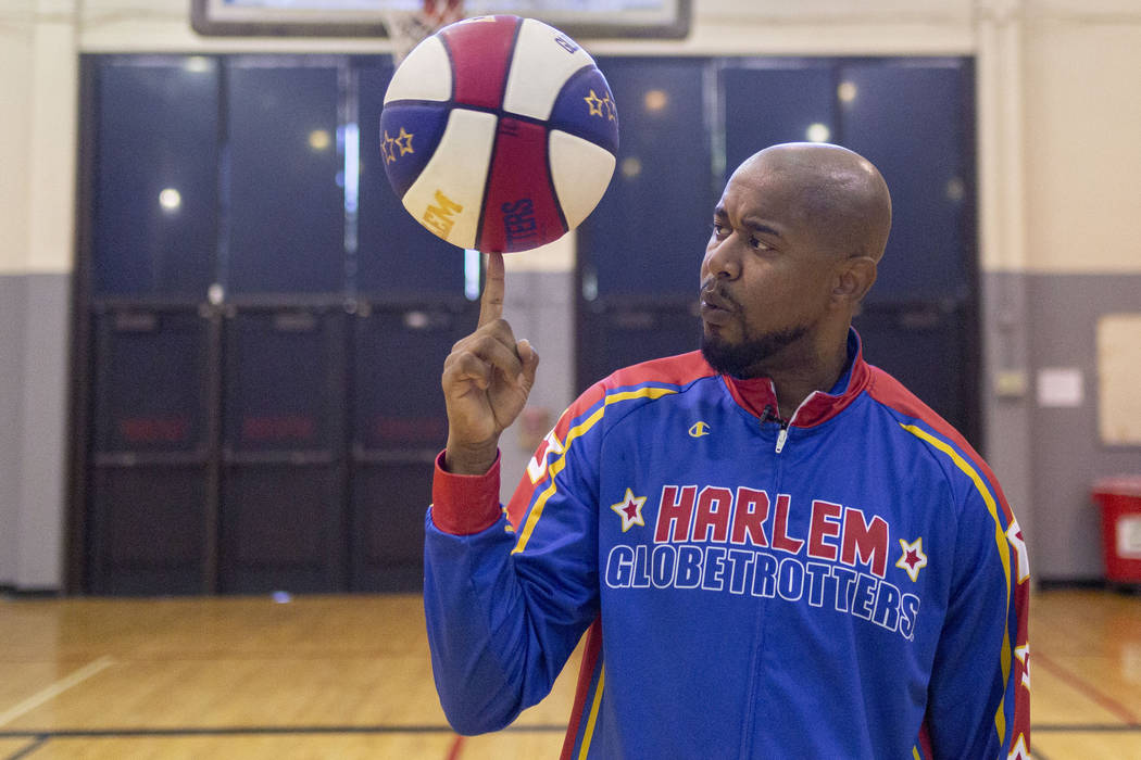 Las Vegas resident and Harlem Globetrotter Scooter Christensen demonstrates tricks at the Dula ...