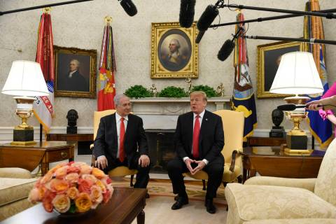 FILE - In this March 25, 2019, file photo, President Donald Trump, right, speaks as Israeli Pri ...