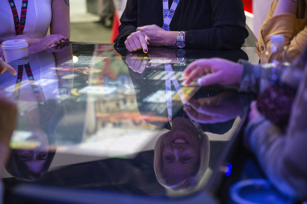 Attendees play Pac-Man, a skill-based game, at Gamblit booth at the 18th annual Global Gaming E ...