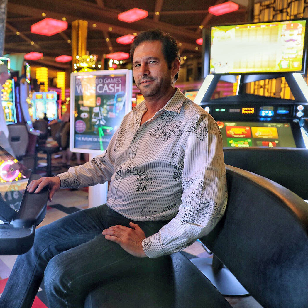 Gamblit CEO Eric Meyerhofer alongside a Model G machine at Planet Hollywood in Las Vegas on Tue ...