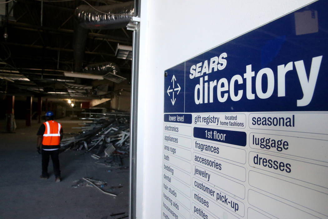 Workers recycle building material inside the former Sears store is shown at the Boulevard Mall ...