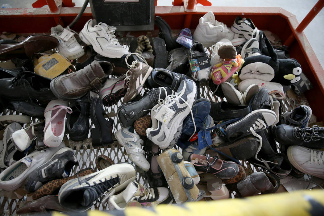 Shoes that were found inside the walls at the former Sears store at the Boulevard Mall in Las V ...