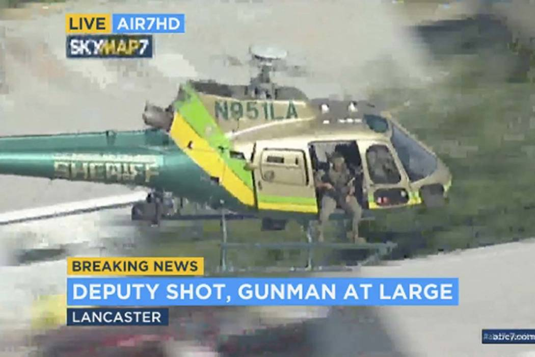 This photo taken from video provided by KABC-TV shows a sheriff's department helicopter with a ...