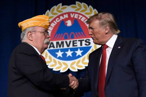 President Donald Trump greets AMVETS national commander Rege Riley at the American Veterans (AM ...