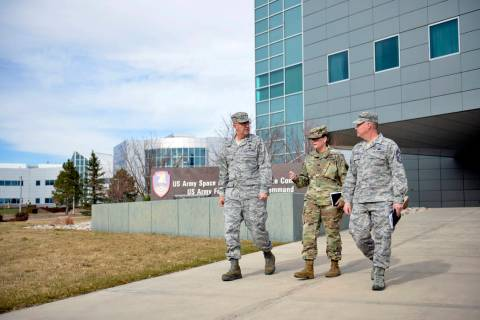 In this image provided by the U.S. Army National Guard, U.S. Air Force Gen. John E. Hyten, left ...