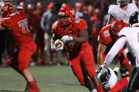 Arbor View's Darius Williams (30) runs through a pocket during second half of the Mountain Regi ...