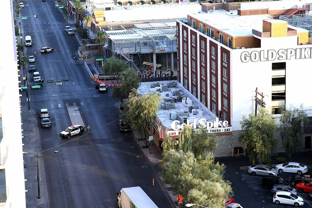 Police remain at 4th Street and Odgen Avenue in downtown Las Vegas, Thursday morning, Aug. 22, ...