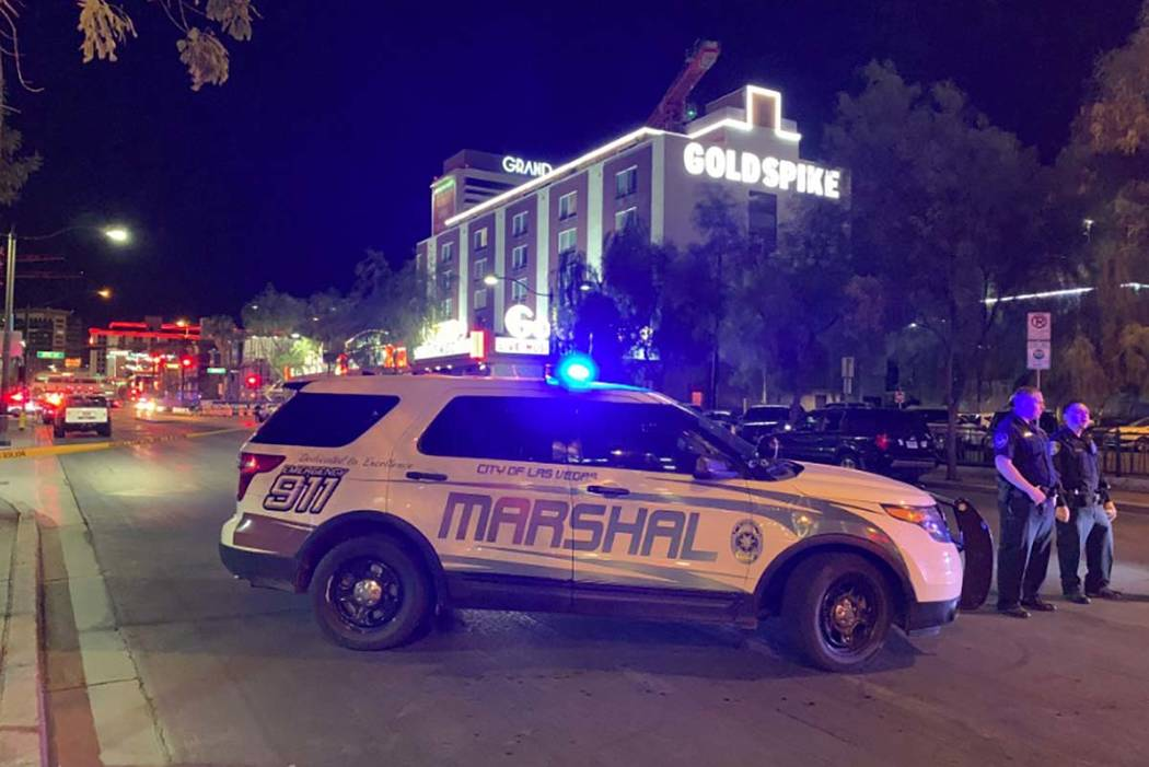 A large police presence is visible Thursday, Aug. 22, 2019, in downtown Las Vegas, at the corne ...