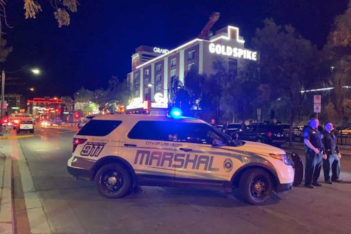 A large law enforcement presence is visible, Thursday, Aug. 22, 2019, in downtown Las Vegas, at ...