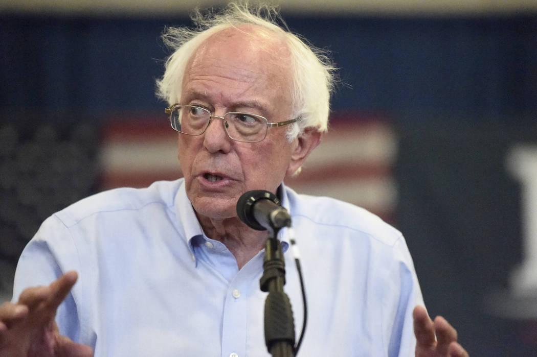 Democratic presidential hopeful Bernie Sanders looks on as panel members discuss his criminal j ...