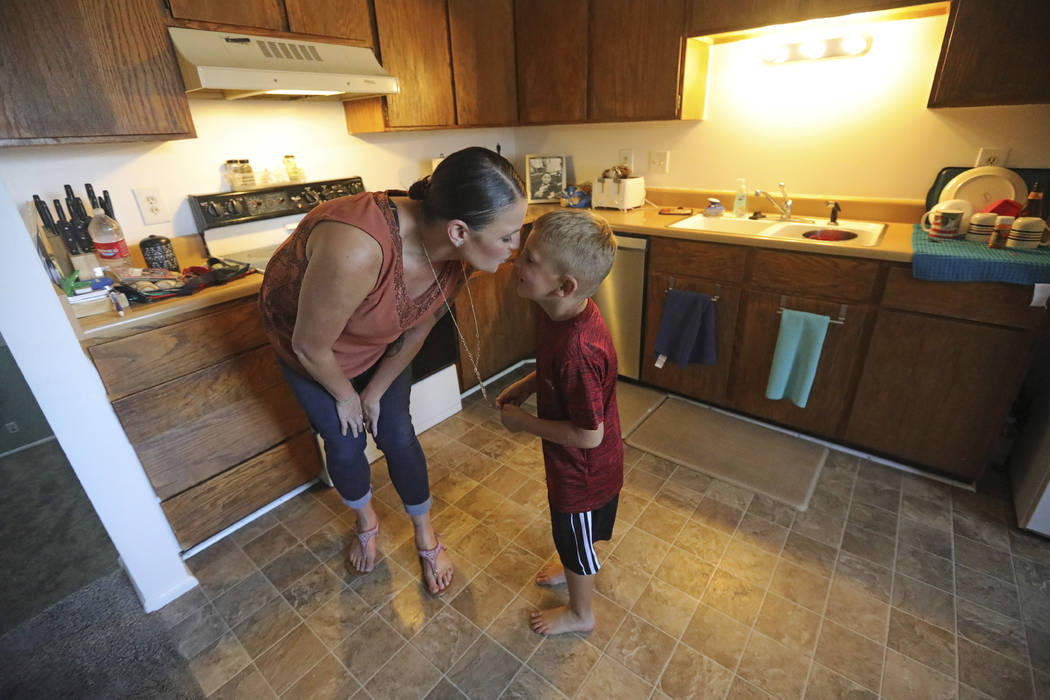 Misty Dotson kisses her son at their home Tuesday, Aug. 20, 2019, in Murray, Utah. Dotson is a ...