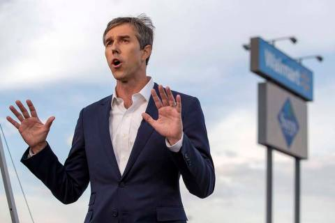 Presidential candidate and former congressman Beto O'Rourke speaks with the media outside the W ...
