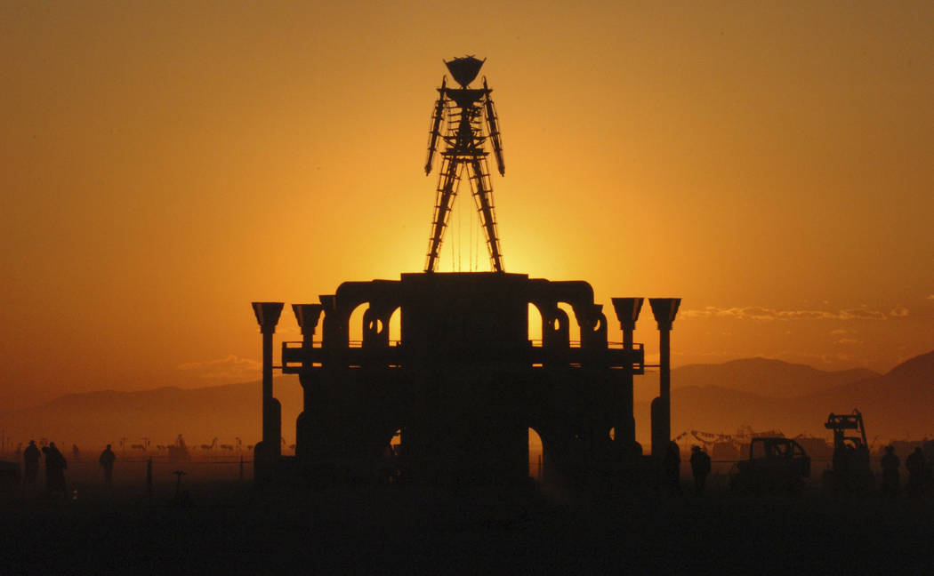 "In this Sept. 2, 2006 file photo, ""The Man,"" a stick figured symbol of the Burning Man art fest ..."