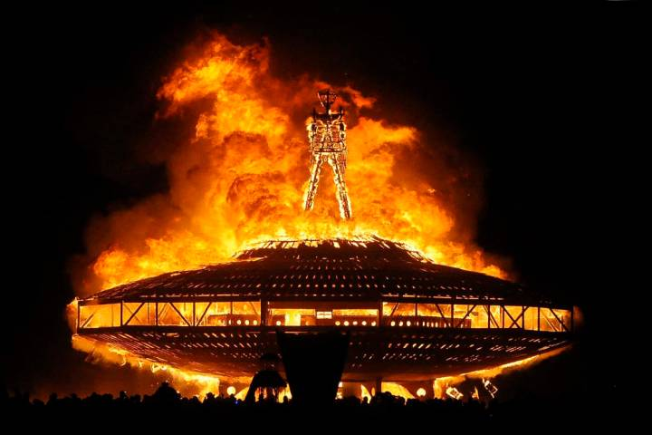 """In this Aug. 31, 2013 file photo, the """"Man"""" burns on the Black Rock Desert at Burning Man near ..."""