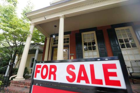 In an Aug. 16, 2019, file photo a for sale signs beckon buyers to homes along Park Avenue in Ri ...