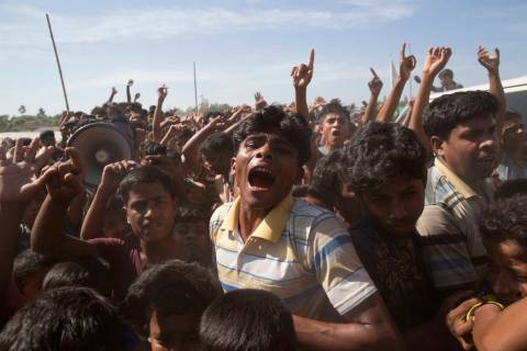 In a file photo dated Thursday, Nov. 15, 2018, Rohingya refugees shout slogans during a protest ...