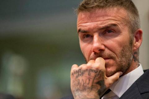David Beckham listens during a public hearing for his proposed Major League Soccer stadium and ...