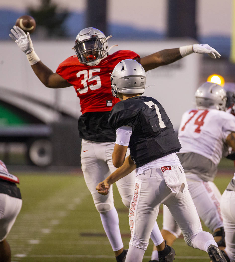 Jacoby Windmon (35) nearly deflects a pass from QB Kenyon Oblad (7) during the UNLV football te ...