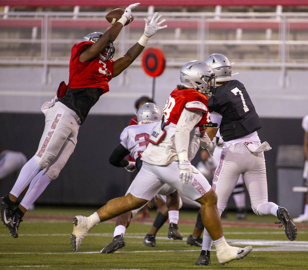 Jacoby Windmon (35) deflects a pass from QB Kenyon Oblad (7) during the UNLV football team scri ...