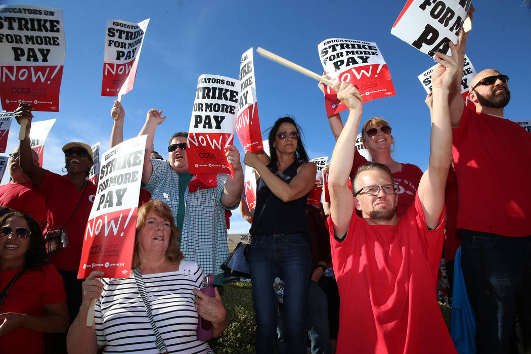 Teachers protest after stalled contract negotiations before a Clark County School District boar ...