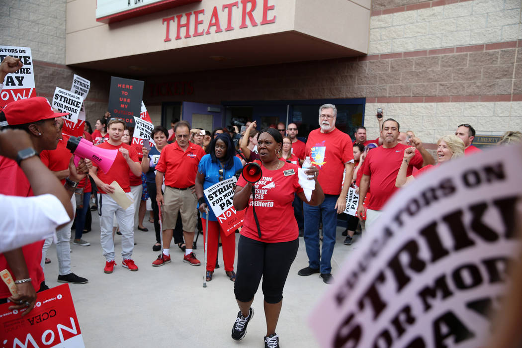 Linda Jone of Clark County Education Association, center, rallies the crowd after a Clark Count ...