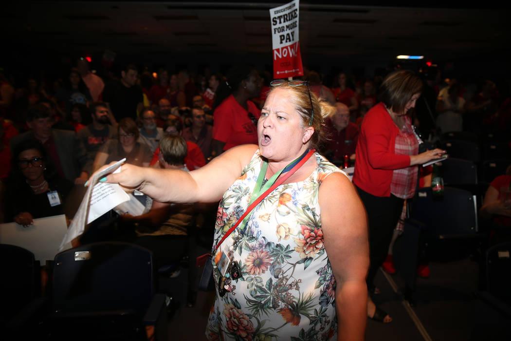 "Nichole Beer, teacher librarian at Martinez Elementary School, chants ""strike"" during ..."