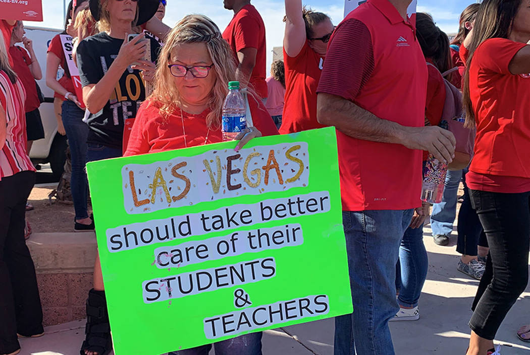 Clark County teachers and their supporters hold a rally outside Liberty High School in Las Vega ...