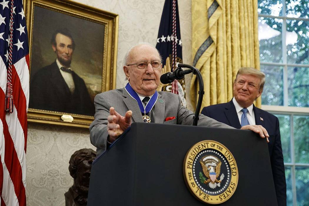 President Donald Trump listens during a Presidential Medal of Freedom ceremony for former NBA b ...