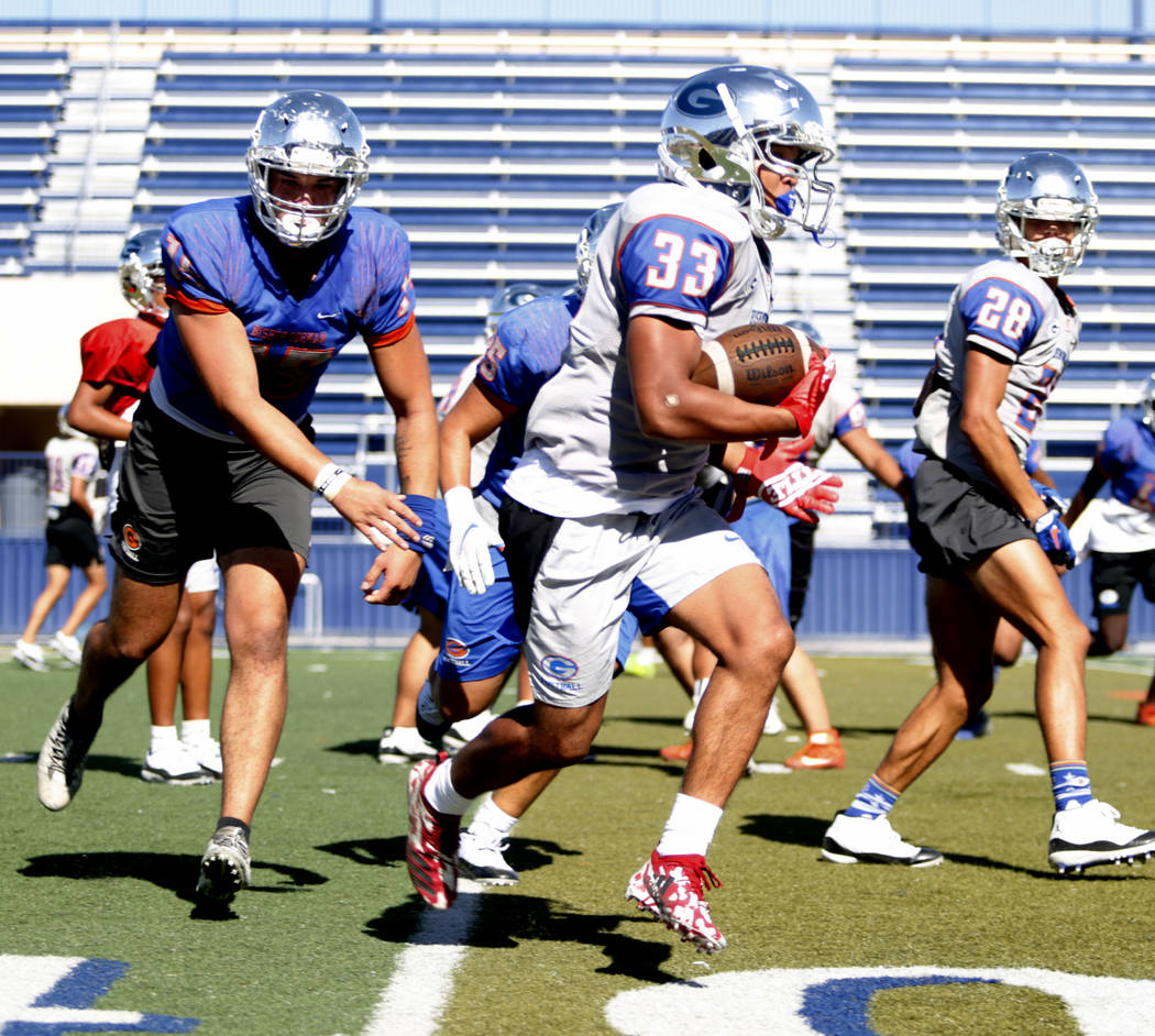 Bishop Gorman's running back Jahsai Shannon (33) participates in a drill during practice at Bis ...