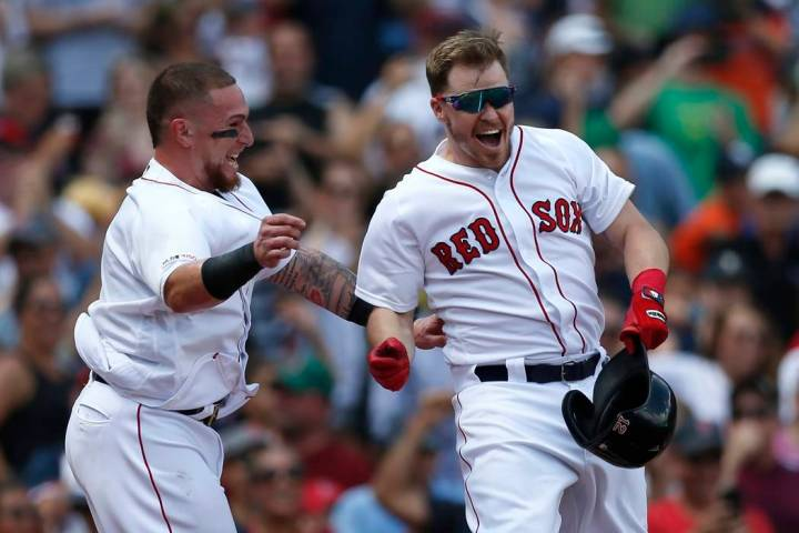 Boston Red Sox's Brock Holt, right, celebrates his game-winning RBI single with Christian Vazqu ...