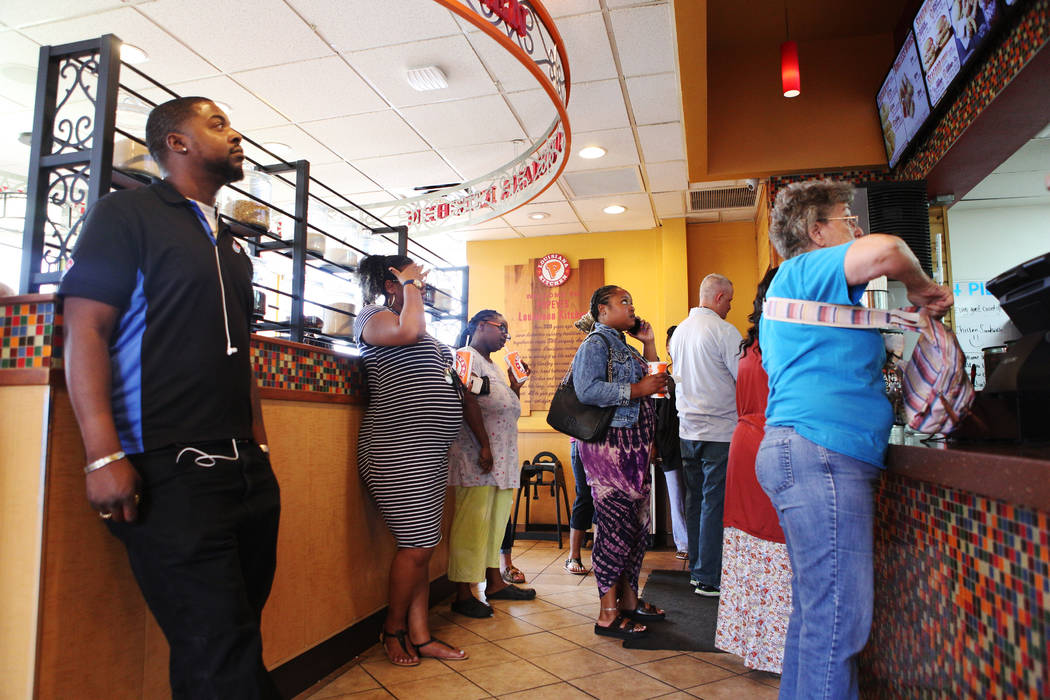 People wait in line, some as long as an hour, for the new chicken sandwich at Popeyes on the co ...