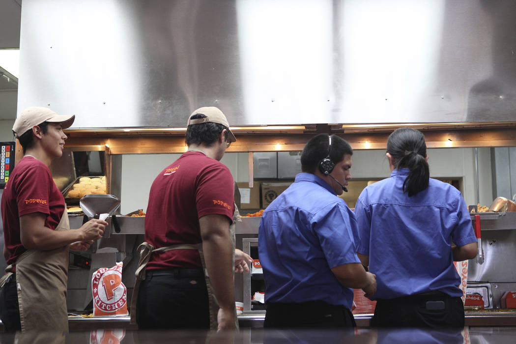 Popeyes employees work around the clock to fulfill orders of the new chicken sandwich at Popeye ...