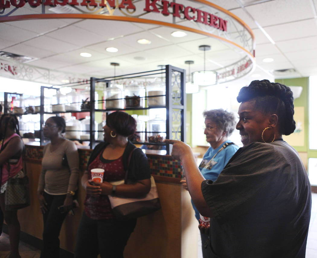 Angie Richard, right, laughs with others as they wait in line for the new chicken sandwich at P ...